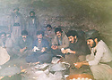 Iraq 1991.In february, after a long walk under the rain, Mahmoud Sangawy and his peshmergas resting in a cave  in Germian .Irak 1991 .En fevrier,apres une longue marche sous la pluie, Mahmoud Sangawy et ses peshmergas se rechauffent autour d'un feu dans une grotte du Germian