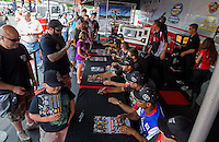 May 30, 2014; Englishtown, NJ, USA; NHRA Team Toyota at an autograph session during qualifying for the Summernationals at Raceway Park. Mandatory Credit: Mark J. Rebilas-