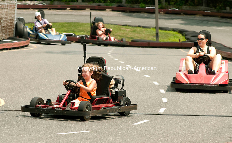 WINSTED, CT 04 AUGUST, 2010-080410JS01-Molly Hale, 8, of Winsted, takes an early lead while racing go carts with her sisters Amanda Carnet, right, Ciara Hale, 10, in back and family friend Andrea Wieciech of Vernon, back left, while enjoying an afternoon at R&amp;B Sports World in Winsted Wednesday. On August 8, the owners of R&amp;B Sports World will be celebrating their 20th year in business. <br /> Jim Shannon Republican-American