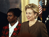 United States President Bill Clinton and first lady Hillary Rodham Clinton host an event in the East Room of the White House advocating expanded use of the internet to place adoptions in Washington, D.C. on November 24, 1998.  From left to right: Charday Mays and the first lady.<br /> Credit: Ron Sachs / CNP