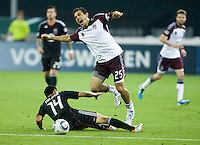 Andy Najar (14)  D.C. United fouls Pablo Mastroeni (25) of the Colorado Rapids during the game at RFK Stadium in Washington, DC.  D.C. United tied the Colorado Rapids, 1-1.
