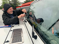 Jeff Jackson of Winslow installs new wiper blades Friday, May 15, 2020, on his Jeep in the rain at AutoZone in Fayetteville before heading home after work. More rain and thunderstorms are expected for the area through the weekend. Visit nwaonline.com/200516Daily/ for today's photo gallery.<br /> (NWA Democrat-Gazette/Andy Shupe)