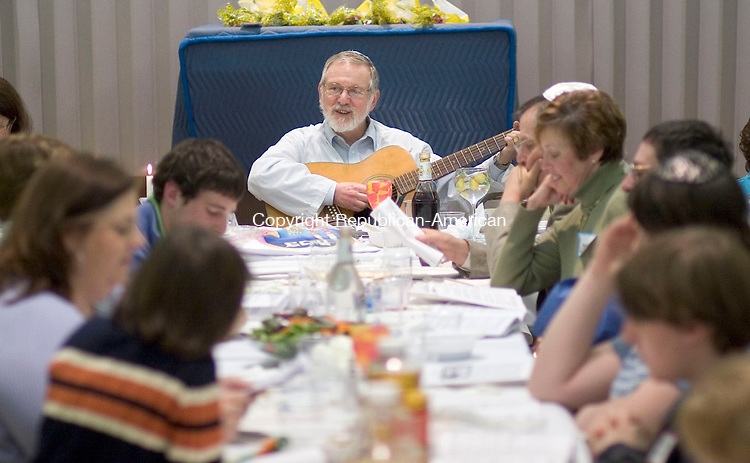 CHESHIRE, CT- 03 APRIL 2007 -040307JW05.jpg -- Rabbi Eric Silver plays a guitar and sings during a Seder  Passover celebration at the Temple Beth David Tuesday evening. Jonathan Wilcox Republican-American