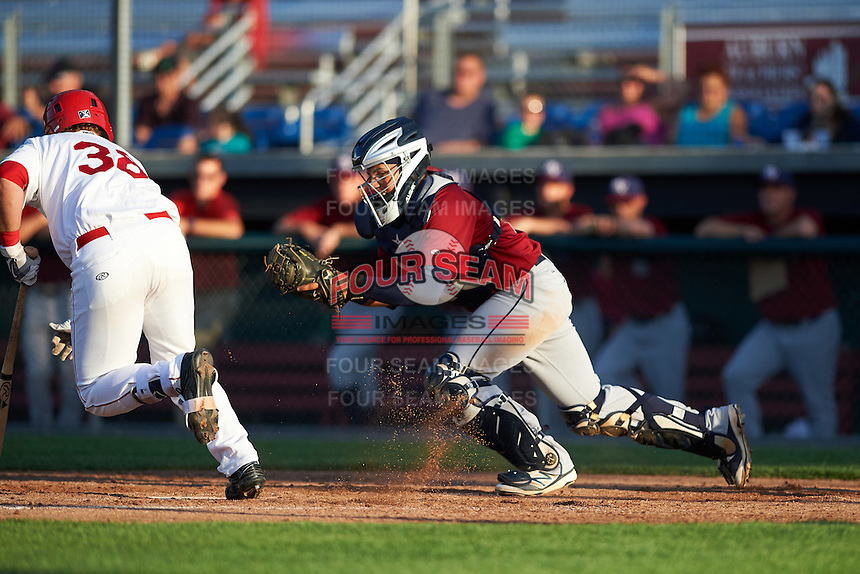 Mahoning Valley Scrappers catcher Gian Paul Gonzalez (16) looks to tag Sheldon Neuse (38) to complete the strikeout during a game against the Auburn Doubledays on July 17, 2016 at Falcon Park in Auburn, New York.  Mahoning Valley defeated Auburn 3-2.  (Mike Janes/Four Seam Images)