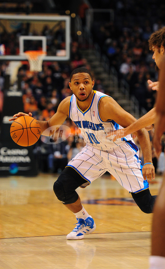 Dec. 26, 2011; Phoenix, AZ, USA; New Orleans Hornets guard Eric Gordon controls the ball under pressure during game against the Phoenix Suns at the US Airways Center. The Hornets defeated the Suns 85-84. Mandatory Credit: Mark J. Rebilas-USA TODAY Sports