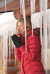 A young woman drinks hot chocolate to fend off the cold in Jackson Hole, Wyoming.