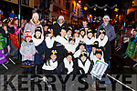 Gaelscoil Faithleann NS pupils marching in the Kiilarney Christmas parade through the packed streets  on Saturday night