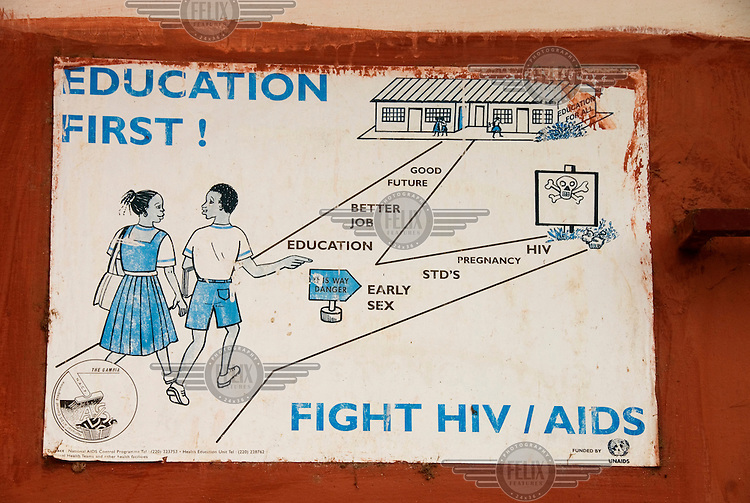 Poster in school urging pupils to stay in education so that they can find a better job and a brighter future. The alternative path, early sex, leads to pregnancy and HIV.