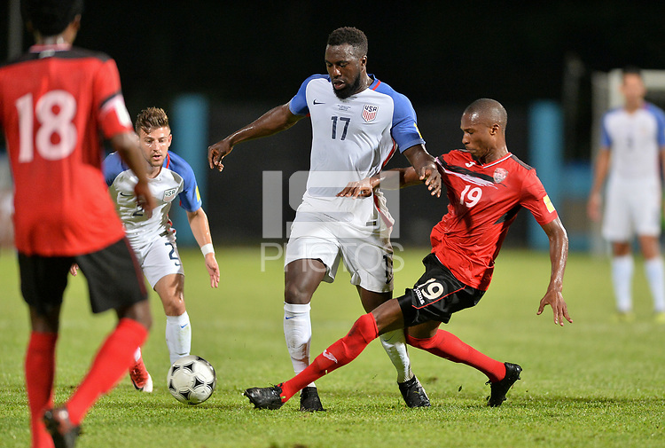 Couva, Trinidad & Tobago - Tuesday Oct. 10, 2017: Jozy Altidore, Kevan George during a 2018 FIFA World Cup Qualifier between the men's national teams of the United States (USA) and Trinidad & Tobago (TRI) at Ato Boldon Stadium.
