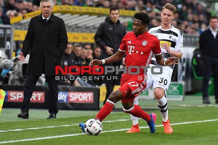 19.03.2017, Borussia-Park, Moenchengladbach, GER, 1.FBL., Borussia M&ouml;nchengladbach. vs. FC Bayern Muenchen<br /> <br /> im Bild / picture shows: <br /> Nico Elvedi (Gladbach #30),im Zweikampf gegen David Alaba (FC Bayern Muenchen #27),Querformat,<br /> <br /> <br /> Foto &copy; nordphoto / Meuter