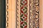 Architecture detail of a carved stone and mosaic border