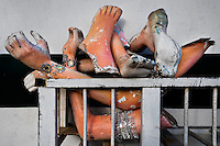 Arms and legs of the carnival statues thrown into a pile in the Samba school warehouse in Rio de Janeiro, Brazil, 15 February 2012. Most of the large carnival floats, colorful designs and fancy costumes are dismantled, cut into pieces or simply thrown into garbage right after the last day of the Carnival. The low-tech materials as fiberglass, plastic or polystyrene, which most of the of the carnival floats and statues are made of, are stocked in the warehouses to be recycled and used in the future parades. However, there is no use for some of the statues so they slowly fall apart into pieces forming a ?Carnival cemetery? in the industrial yards around the port of Rio de Janeiro.