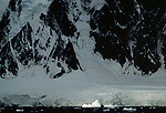 I was intrigued by the way this iceberg was singled out by a shaft of light, sitting it apart from the dark ocean and the shadowy landmass of an island fof the Antarctic Peninsula, Antarctica.
