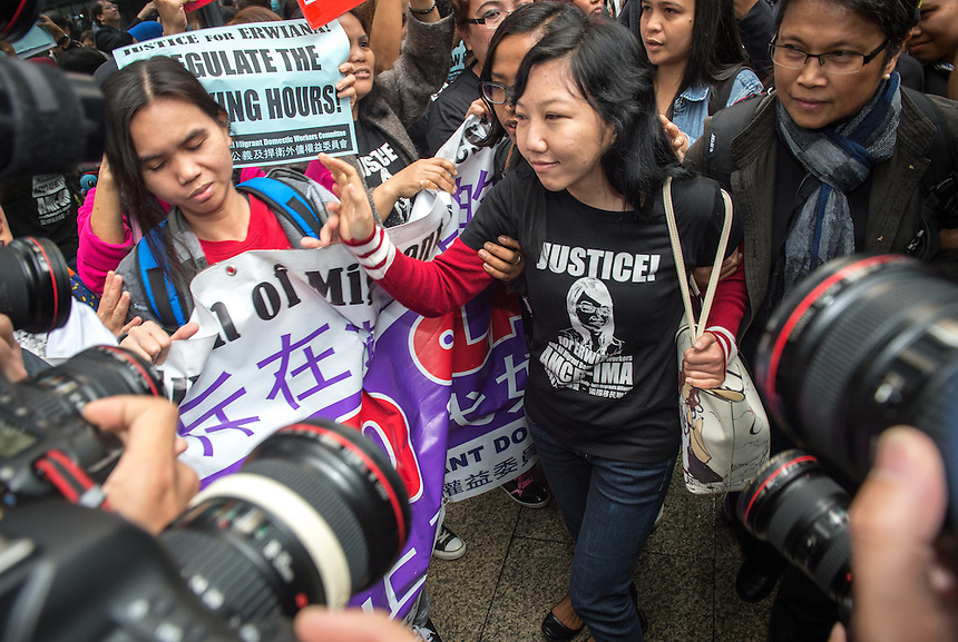 Abused Indonesian domestic helper Erwiana Sulistyaningsih is met by supporters as she arrives at the District Court in Wan Chai, Hong Kong to hear the sentencing of her former employer, Law Wan-tung.<br /> 27th February 2015. 27.02.15<br /> &copy;Jayne Russell