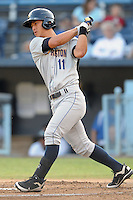 Charleston River Dogs right fielder Rob Refsnyder #11 swings at  a pitch during a game against the Asheville Tourists at McCormick Field on August 15, 2012 in Asheville, North Carolina. The Tourists defeated the River Dogs 6-0. (Tony Farlow/Four Seam Images).