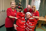 TATA Steel<br /> Keith Fallon from TATA Steel delivering christmas presents to staff of Age Cymru Linda Goldsworthy, Glynn Thomas and Ann Smith to hand out to patients at St Woolos Hospital in Newport.<br /> <br /> 17.12.13<br /> &copy;Steve Pope-FOTOWALES