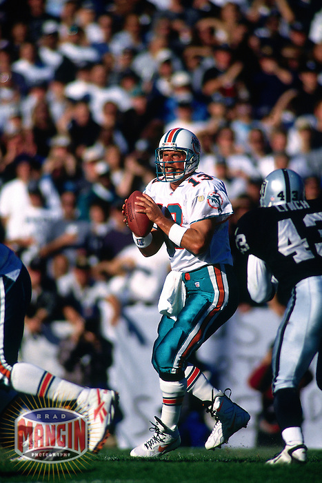 OAKLAND, CA - Quarterback Dan Marino of the Miami Dolphins in action during a game against the Oakland Raiders at the Oakland Coliseum in Oakland, California in 1996. Photo by Brad Mangin