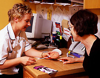 A doctor in consultation with a patient. Date: 31.10.2005. <br />