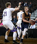 SIOUX FALLS, SD - MARCH 10:  Mark Albers #12 from Marian drives baseline against Matt Duniphan #21 from the College of Idaho during their quarterfinal game at the 2018 NAIA DII Men's Basketball Championship at the Sanford Pentagon in Sioux Falls. (Photo by Dave Eggen/Inertia)