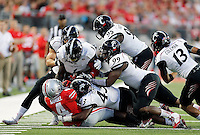 Ohio State Buckeyes running back Curtis Samuel (4) gets brought down by Bearcats during the second quarter of Saturday's NCAA Division I football game at Ohio Stadium in Columbus on September 27, 2014. (Columbus Dispatch photo by Jonathan Quilter)
