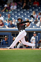 Nashville Sounds center fielder Kenny Wilson (11) follows through on a swing during a game against the New Orleans Baby Cakes on May 1, 2017 at First Tennessee Park in Nashville, Tennessee.  Nashville defeated New Orleans 6-4.  (Mike Janes/Four Seam Images)
