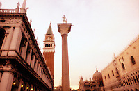 Italy, Venice, Piazzetta San Marco with column of San Theodore, Biblioteca Marciana (St. Mark's Library) the Campanile, Saint Mark's Basilica and the Doge's Palace