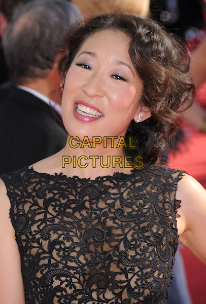 SANDRA OH .60th Annual Primetime Emmy Awards held at the Nokia Theatre, Los Angeles, California, USA,  21 September 2008..emmys red carpet arrivals portrait headshot  black sheer see through dress.CAP/ADM/BP.©Byron Purvis/Admedia/Capital PIctures