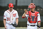 VIERA, FL-  FEBRUARY 26:  Max Scherzer and Jose Lobaton of the Washington Nationals talk after completing  a bullpen session during the Washington Nationals Spring Training at Space Coast Stadium in Viera, FL (Photo by Donald Miralle) *** Local Caption ***