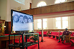 Lemarse Washington sits during the showing of a video about the history of 16th Street Baptist Church during a tour on August 13, 2013 in downtown Birmingham, Alabama. In 1963, four girls were killed when a bomb under the church's side steps went off.
