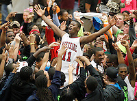 Westside fans celebrate Friday's 60-56 win over rival T.L. Hanna by carrying Kyreen Sadler across the court. Sadler drew a charge in the closing seconds of the second overtime period to secure the Rams' win.