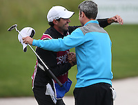 ROSS FISHER (ENG) celebrates with caddie Chris Harmston as he becomes the Champion Golfer of The Tshwane Open 2014 at the Els (Copperleaf) Golf Club, City of Tshwane, Pretoria, South Africa . Picture:  David Lloyd / www.golffile.ie