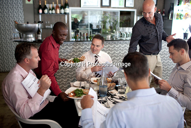 CAPE TOWN, SOUTH AFRICA - MARCH 22: Manager Raphael talks to guests at bizerca bistro on March 22, 2012 in Cape Town, South Africa (Photo by Per-Anders Pettersson)