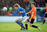 St Johnstone v Dundee United.....29.12.13   SPFL<br /> Murray Davidson is fouled by Andrew Robertson<br /> Picture by Graeme Hart.<br /> Copyright Perthshire Picture Agency<br /> Tel: 01738 623350  Mobile: 07990 594431