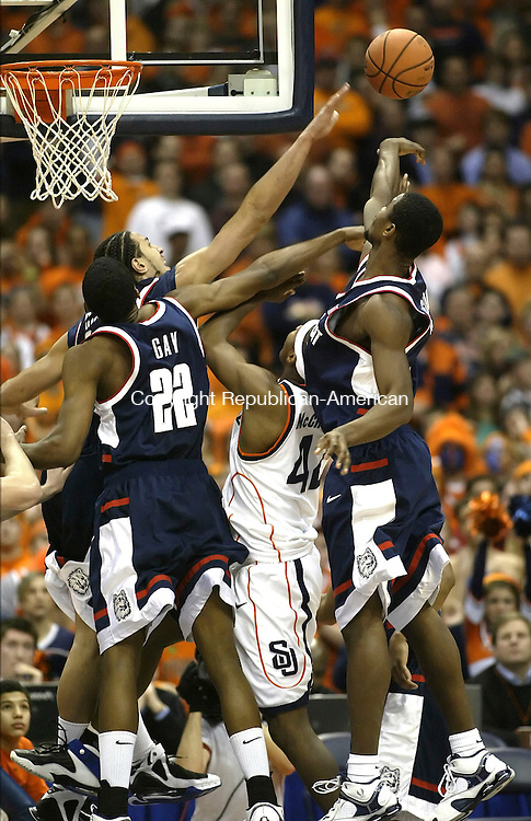 SYRACUSE, NY 16 JANUARY 2005 011605BZ17-      UConn #21, Josh Boone, #22, Rudy Gay, and  #11, Hilton Armstrong combine to deny Syracuse #42, Louie McCroskey <br /> during their game at the carrier Dome at Syracuse University Monday night. <br /> Jamison C. Bazinet Republican-American