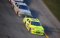 Jul. 5, 2008; Daytona Beach, FL, USA; NASCAR Sprint Cup Series driver Paul Menard (15) leads Dale Earnhardt Jr (88) during the Coke Zero 400 at Daytona International Speedway. Mandatory Credit: Mark J. Rebilas-