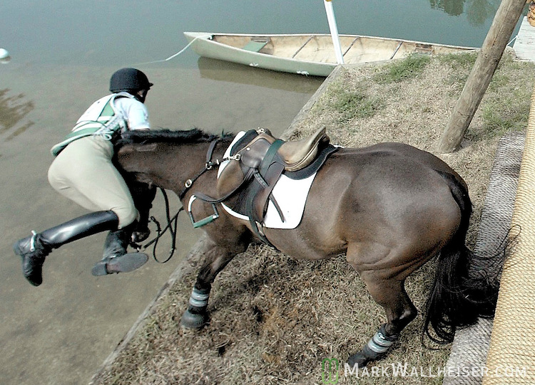 "Adrienne Iorio-Borden seperates from ""Show of Heart landing in the water after going over Apalachee Bay jump.  The horse balked at the four foot drop into the water after coming over a four foot high jump and Iorio-Borden went over the horses head.  They were in the CIC-W Three Star Division."