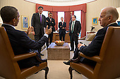 United States President Barack Obama and Vice President Joe Biden talk with senior advisors in the Oval Office, November 16, 2012. Standing, from left, are: Chief of Staff Jack Lew; Rob Nabors, Director of Legislative Affairs; Treasury Secretary Timothy Geithner; and National Economic Council Director Gene Sperling. .Mandatory Credit: Pete Souza - White House via CNP