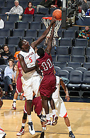 Nov 6, 2010; Charlottesville, VA, USA; Virginia Cavaliers c Assane Sene (5) reaches for the rebound Saturday afternoon in exhibition action at John Paul Jones Arena. The Virginia men's basketball team recorded an 82-50 victory over Roanoke College.