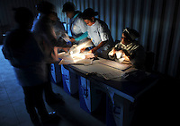 A polling station in the Du Noon squatter area on the day of the 2009 general election. Election officials ready themselves for the start of voting in the pre-dawn light.