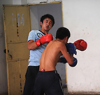 Young boxers train out under the guidance of their trainer, Qi Moxiang, in Huili Middle School in Sichuan Province, China. The group of young boxers are hoping to make it to become some of China's first professional boxers...PHOTO BY SINOPIX