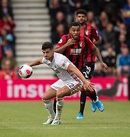 Sheffield United's John Egan (left) under pressure from Bournemouth's Joshua King (right) <br /> <br /> Photographer David Horton/CameraSport<br /> <br /> The Premier League - Bournemouth v Sheffield United - Saturday 10th August 2019 - Vitality Stadium - Bournemouth<br /> <br /> World Copyright © 2019 CameraSport. All rights reserved. 43 Linden Ave. Countesthorpe. Leicester. England. LE8 5PG - Tel: +44 (0) 116 277 4147 - admin@camerasport.com - www.camerasport.com