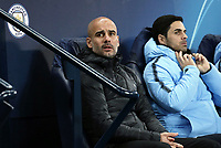 Manchester City manager Josep Guardiola takes his seat ahead of kick-off<br /> <br /> Photographer Rich Linley/CameraSport<br /> <br /> UEFA Champions League Group F - Manchester City v TSG 1899 Hoffenheim - Wednesday 12th December 2018 - The Etihad - Manchester<br />  <br /> World Copyright © 2018 CameraSport. All rights reserved. 43 Linden Ave. Countesthorpe. Leicester. England. LE8 5PG - Tel: +44 (0) 116 277 4147 - admin@camerasport.com - www.camerasport.com