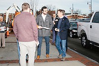 Staff and supporters greet Kentucky senator and Republican presidential candidate Rand Paul has he arrives outside Norton's Classic Cafe in Nashua, New Hampshire. Paul greeted people at the diner before a group of campaign volunteers canvassed Nashua-area neighborhoods.