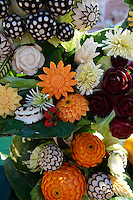 Arrangement of vegetables sculpted into flowers