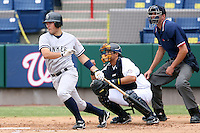 April 15, 2009:  Catcher Austin Romine (12) of the Tampa Yankees, Florida State League Class-A affiliate of the New York Yankees, at bat in front of catcher Anderson De La Rosa and umpire Travis Carlson during a game at Space Coast Stadium in Viera, FL.  Photo by:  Mike Janes/Four Seam Images