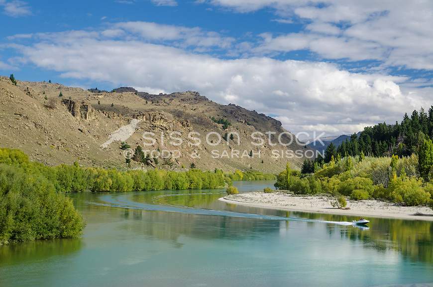 A jetboat along the Clutha River near Alexandra in summer, Central Otago, South Island, New Zealand - stock photo, canvas, fine art print