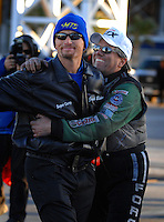 Jan 21, 2007; Las Vegas, NV, USA; NHRA Funny Car driver John Force hugs Top Fuel Dragster driver Jack Beckman during preseason testing at The Strip at Las Vegas Motor Speedway in Las Vegas, NV. Mandatory Credit: Mark J. Rebilas