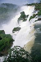 The thunderous noise and the spray thrown off by the Iguazu Falls are liable to make spectators on the Argentine bank slightly dizzy. The Falls consist of some 275 separate waterfalls - or, in the rainy season, 350 - and the distance from top to bottom is about 250 feet.