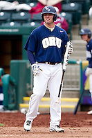 Brandon King (25) of the Oral Roberts Golden Eagles reads batting signs during a game against the Missouri State Bears on March 27, 2011 at Hammons Field in Springfield, Missouri.  Photo By David Welker/Four Seam Images