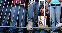 Andrew Lynn, 9, of Kanawha kneels in the front row while listning to Democratic presidential nominee Sen. Barack Obama speak during a campaign rally in downtown Des Moines, October 31, 2008, just four days before the general election.  Obama returned Iowa, where he won his first victory on his path to the nomination- the Iowa caucuses, eleven months before.